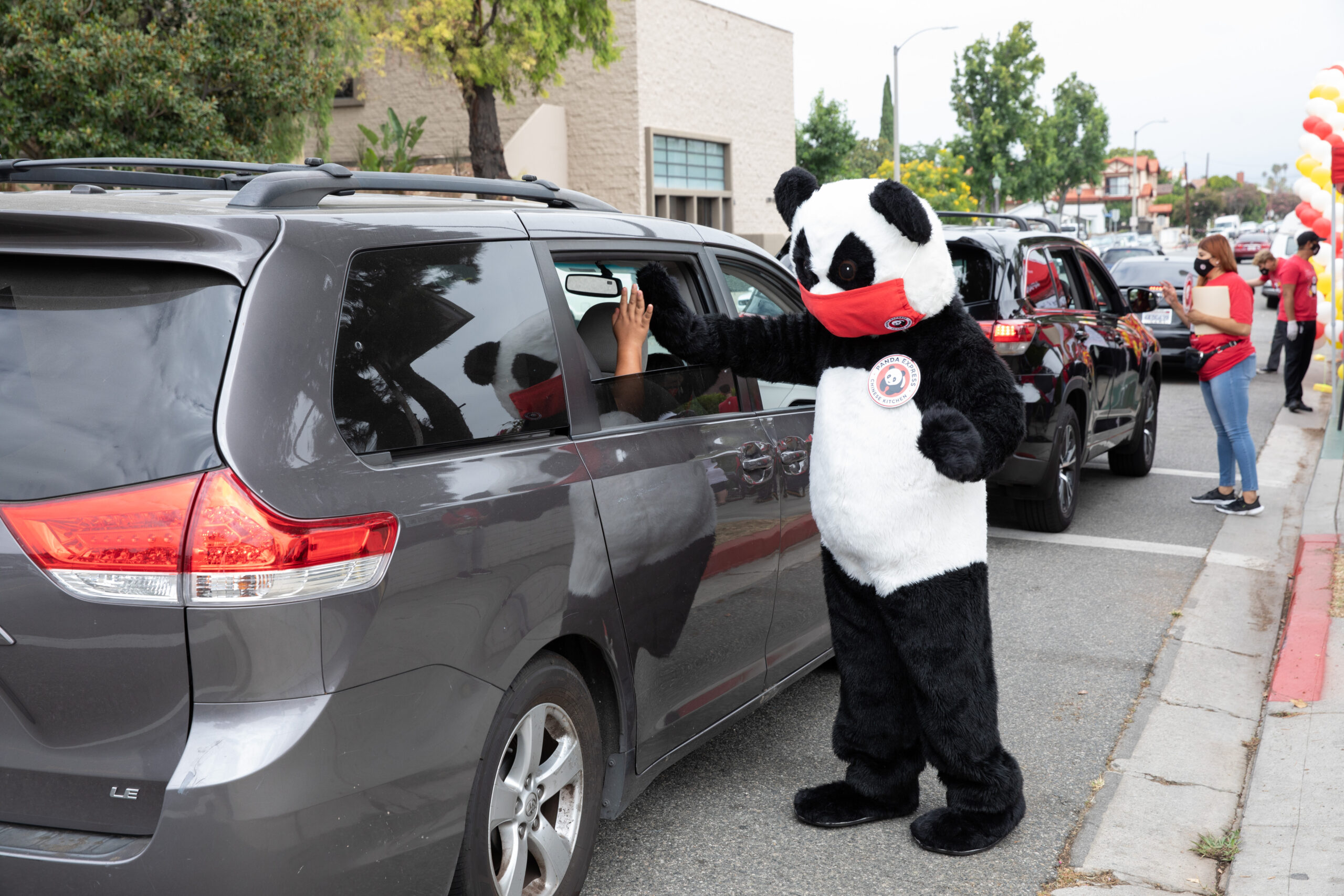 Children of Boys & Girls Club of America celebrate Panda Cares Day™ with Panda Express with a drive-by party on Aug. 6, 2020, in Monterey Park, Calif. There are 88 Panda Cares Day™ events happening at other Boys & Girls Club locations and Children's Miracle Network Hospitals. (Mark Von Holden/AP Images for Panda Express)